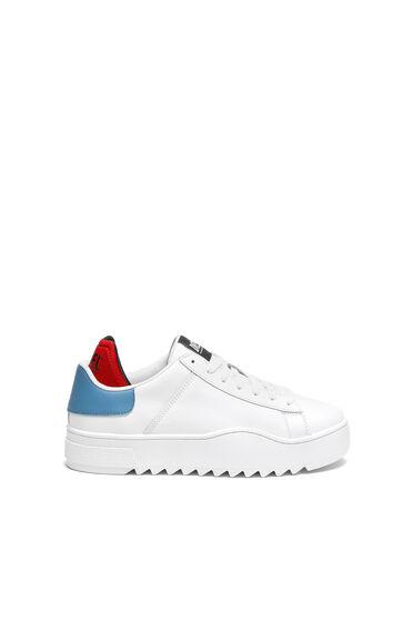 Sneakers en cuir avec bordure contrastante